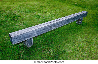The Wooden bench on green grass floor