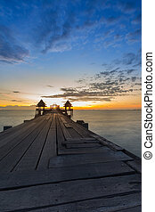 The wooden Bridge and Pavilion into sea during sunset