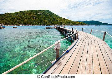 The wooden bridge at a beautiful beach