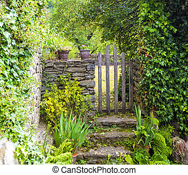 The Wooden gate in a stone wall on a farm