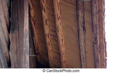 The wooden log house cabin made out of logs and view of cedar shingle shake roof