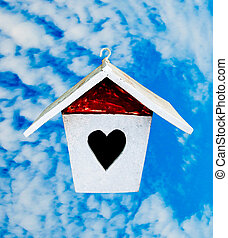 The Wooden of birdhouse on blue sky background