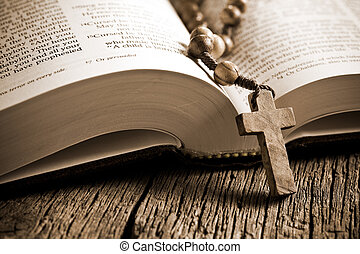 wooden rosary on the open Bible