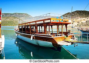 The wooden yacht in harbor on Turkish resort, Antalya, Turkey