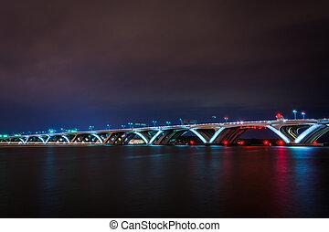 The Woodrow Wilson Bridge and Potomac River at night, seen from Alexandria, Virginia.