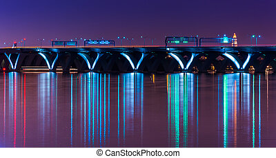 The Woodrow Wilson Bridge at night, seen from National Harbor, Maryland.