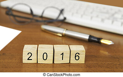 The word 2016 on wood stamp