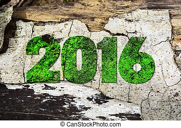 "The word ""2016"" written in rusty metal letterpress type sitting on a wooden ledge background."