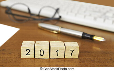 The word 2017 on wood stamp