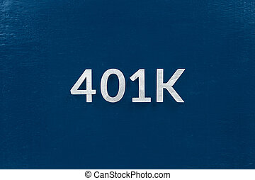 the word 401k laid with silver brushed metal letters on classic blue surface - centered in flat lay directly above perspective