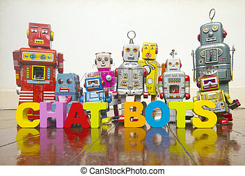 the word A CHAT BOTS with wooden letters and retro toy robots on an old wooden floor