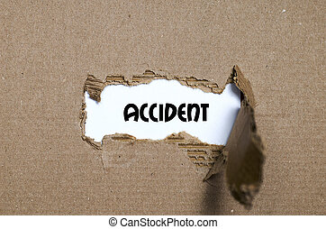 The word accident appearing behind torn paper