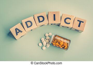 The word addict on a table