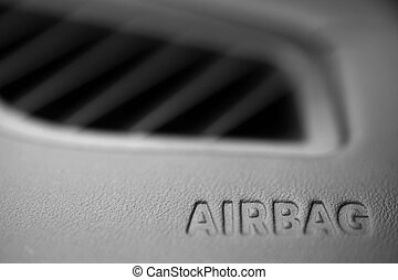 """Airbag - The word """"Airbag"""" is written inside a car."""
