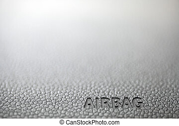 "Airbag - The word ""Airbag"" is written on a car's dashboard."