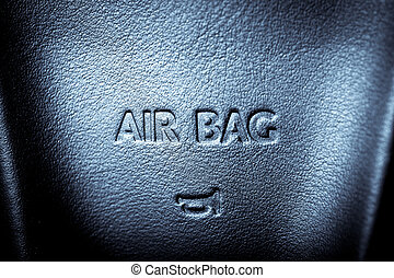 "Airbag - The word ""Airbag"" is written on a car's steering..."