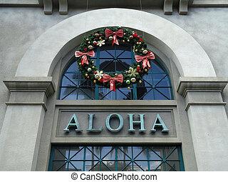 The Word Aloha and Christmas Wreath on side of Aloha Tower