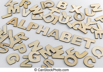 The word alphabet in wooden letters