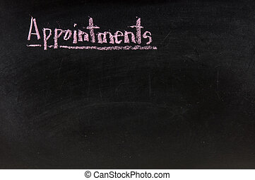The word appointments handwritten with chalk on a blackboard