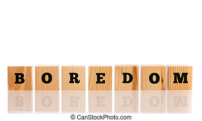 The word - Boredom- on wooden cubes arranged in a line on a...