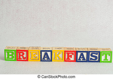 The word breakfast spelled with alphabet blocks isolated on a white background
