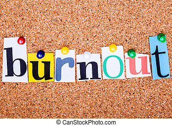 The word Burnout in cut out magazine letters pinned to a cork no