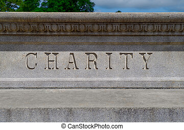 The Word Charity Written in Stone