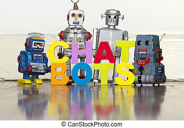 the word CHAT BOTS with 4 retro robots on a wooden floor