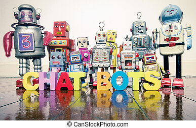 the word CHAT BOTS with wooden letters and retro toy robots on an old wooden floor
