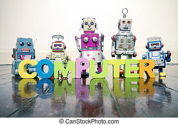 the word COMPUTER with wooden letters and retro toy robots on an old wooden floor