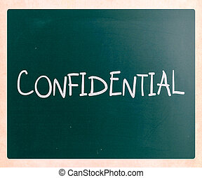 "The word ""Confidential"" handwritten with white chalk on a blackboard"