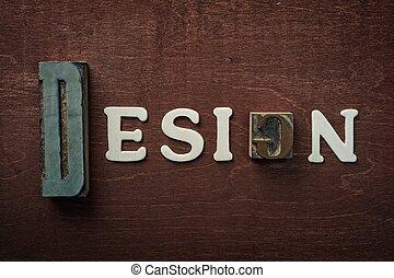 The word design written on wooden background