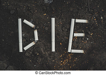 the word die written cigarettes. The dangers of Smoking. ...