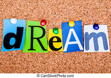 The word Dream in cut out magazine letters pinned to a cork...