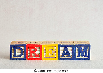 The word dream spelled with colorful blocks isolated on a white background