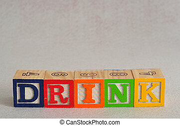 The word drink spelled with alphabet blocks isolated on a white background