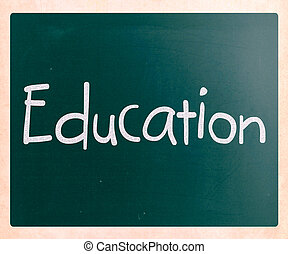 "The word ""Education"" handwritten with white chalk on a blackboard"