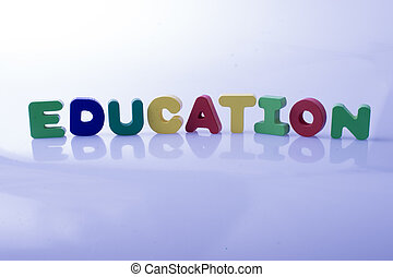 the word EDUCATION written with letter blocks