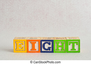 The word eight (8) spelled with colorful alphabet blocks isolated against a white background