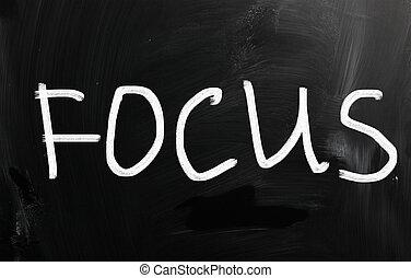 "The word ""Focus"" handwritten with white chalk on a blackboard"