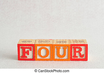 The word four (4) spelled with colorful alphabet blocks isolated against a white background