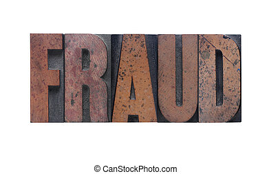 fraud - the word \'fraud\' in old ink-stained wood type