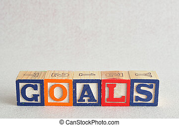 The word goals spelled with colorful alphabet blocks isolated against a white background