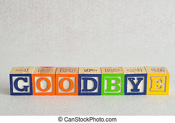 The word goodbye spelled with colorful alphabet blocks isolated against a white background
