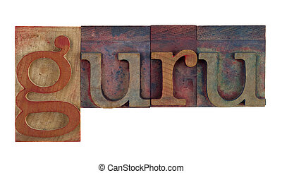 the word guru in vintage wooden letterpress type blocks, stained by color ink, isolated on white