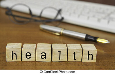 The word health on wood stamp