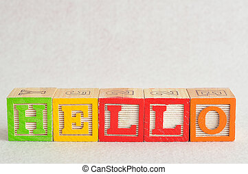 The word hello spelled with colorful alphabet blocks isolated against a white background