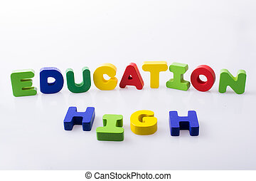the word HIGH EDUCATION written with letter blocks