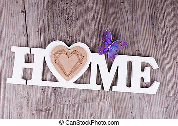 The word Home in white letters with butterfly