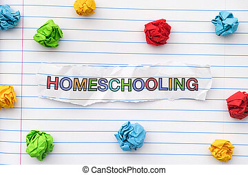 The word Homeschooling written on a lined notebook sheet with some crumpled paper balls around it